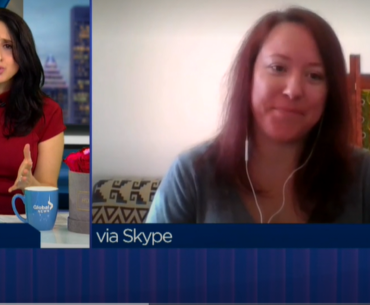 Laura, a reporter for Global News, is on the left half of the image. She is interviewing Jessica from Geordie Theatre via Skype. Jessica appears on the right.